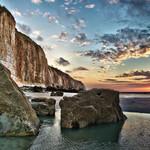 Plage, falaise et coucher de soleil